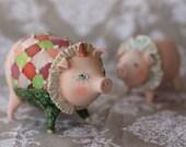 Harleswin. Little ceramic sculpture. Happy pig.