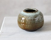 Small Wheel thrown stoneware Clay Bowl with light blue speckled translucent glaze