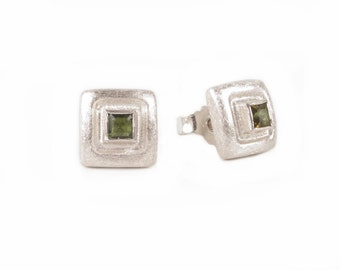 square silver studs with green tourmalines