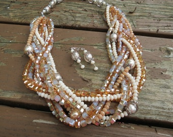 Nine Strands of Braided Cream, Tan and Warm Amber Crystals with Pearls and Glass Beads