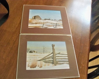 a pair of winter  farm view prints matted