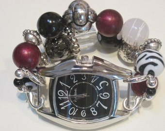 Zebra, maroon, black, clear, white and silver interchangeable. includes black watch face