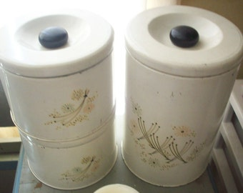 Shabby Set lithographed tin kitchen canisters. Nifty 50s atomic pastel flower pattern. Clean. Genuine Vintage Chic.