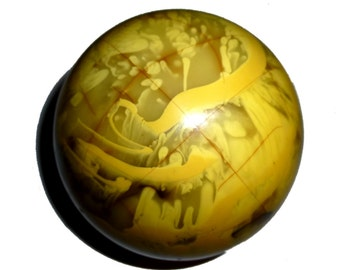 Solid Bakelite Orb Paperweight. Three and a half inches in diamter!  Swirled Brown and Yellow Vintage Catalin Bakelite.