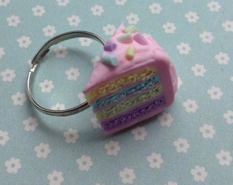 Pretty pastel pink layer cake with pastel sprinkle silver plated adjustable ring
