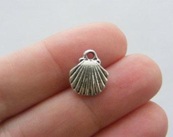 12 Shell charms tibetan silver FF194