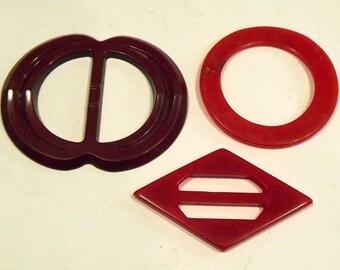 Set of 3 red belt buckles