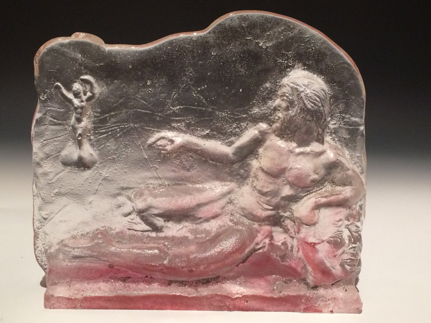 Cast glass bas relief figure sculpture naked man and woman