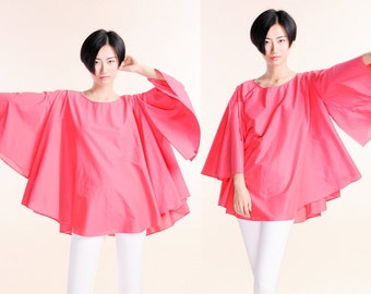 Put on a large loose red shirt