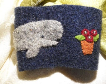 Felted wool coffee cozy with A pot of petunias with a sperm whale, Hitchhikers Guide