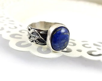 Sterling silver metalwork ring with blue lapis, ornament band