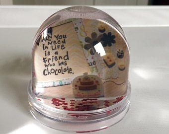 snow globe with chocolate theme in yellow