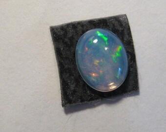 Ethiopian Crystal Opal cab .................  9 x 7 x 3.5 mm .........           B1604