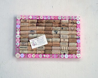 Pink wine cork message board decorated with buttons