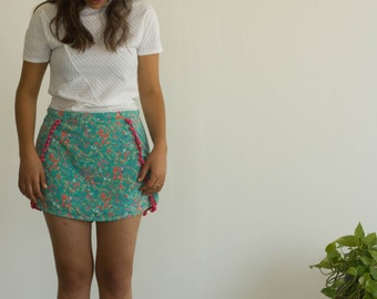 Summer floral turquoise skirt with neon pink pom-poms