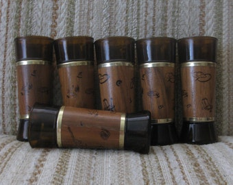 A Set of Six Siesta Ware Genuine Walnut Wrapped Tall Glasses