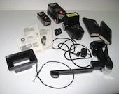 Vivitar 283 Flash With Pistol Grip, Shutter Release, Varipower VP-1, Sensor Adapter, Lens/Filter Adapter, Lens Kit , Filter Kit, Manuals