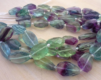 Pretty faceted flourite nugget beads 9-18mm 1/2 strand