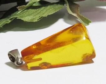 Pendant of natural genuine transparent cognac colour Baltic amber./ 100% Natural Genuine Baltic Amber.