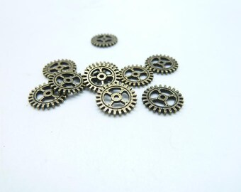 100pcs 10mm Antique Bronze Filigree Mini Gear Charms Pendant C8048