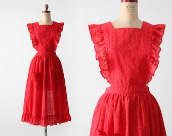 1960s eyelet ruffle apron, vintage red cross back apron dress