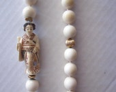 vintage geisha and white bead necklace
