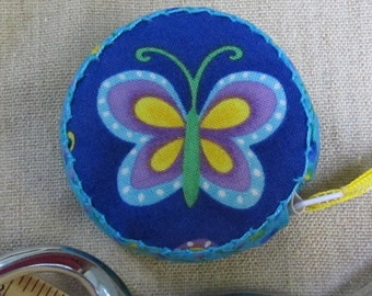 Retractable tape measure, covered with butterfly fabric
