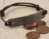 Antiqued copper plate and leather bracelet personalised as you wish.... Unisex