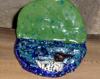 Ceramic Loon cell phone holder handmade in US from a lump of clay.