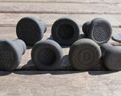Seven Black Bottle Stoppers from Scotland with Patterns and Letters