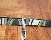 1.25 inch black, gray, and silver faux leather and satin trim, one yard, geometric tape, pieced trim belt supply
