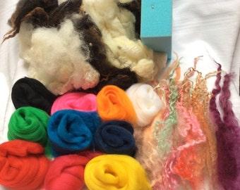 Needlefelt kit. Includes washed British fleece, 10 shades of Merino tops,sponge,wool curls, 2 needles & instructions. Felting. 'Circus time'