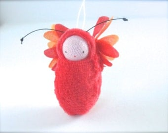 Red flower fairy baby ornament