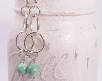 Silver tone and Green dangle earring