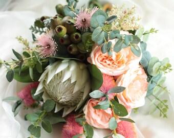 Ms Montville  - Bride's bouquet. Australian natives. Queen protea, roses, flowering gum, bottle brush, gumnuts.