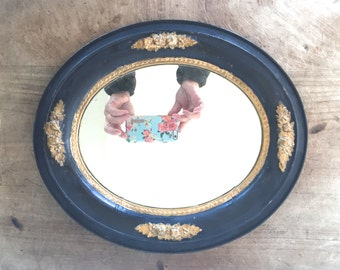 Antique victorian frame with a mirror.