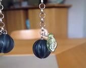 Earring with midnight blue glass bead on a chain/ oorring met een nachtblauwe matte glazen kraal aan het ketting