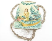 Early 1900's Victorian Die Cut and Tinsel Scrap Christmas Ornament of Girl in Boat, with Angel