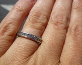 Platinum wedding band or anniversay band  heavy, nice quality  3.3 mm wide channel set