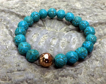 Carved turquoise stretch bracelet and golden  focal  by Lyrisgems