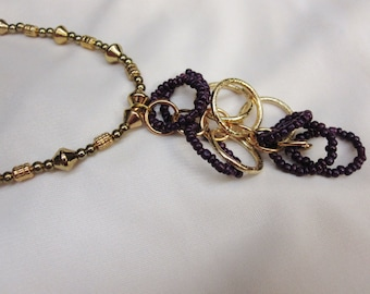 Dangling Gold and Purple Circles hang from this Gold Beaded 15 and a Half Inch Choker Necklace with Sturdy Magnetic Clasp
