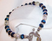 Metallic blue 6mm crystal oval bracelet with daisy spacers and lace beads, twisted heart toggle clasp 7 inch