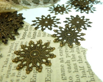 20 filagree spacer beads in antique bronze snowflake design 20 mm
