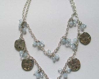 Vintage Jewelry   Silver tone Double chain necklace with sanddollar charm dangles.19 inch no markings.