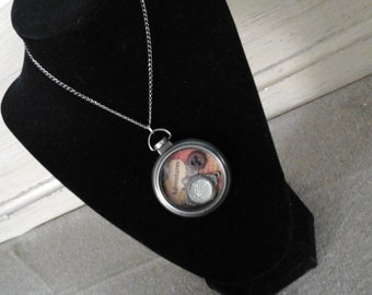 """Steampunk locket features gear, trinket and old book type """"adventure"""",  hand made jewelry one of a kind OOAK"""