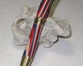 American Patriot pens with turned top of red white blue plywood, available in either antique brass or bright chrome.
