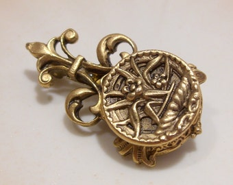 Gold Tone Scrolled and Embossed Button Brooch