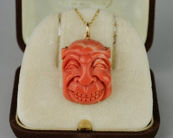 A fabulous pre 1940 japanese salmon coral face large pendant
