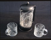 Finely etched  leaves compliment this set of Bodum french press coffee pot with matching cups .
