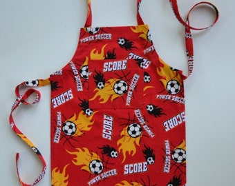 Toddler/boy's or girl's apron, soccer balls, gift idea, apron with pocket, soccer fans, birthday, adjustable apron, sizes 1 to 6.
